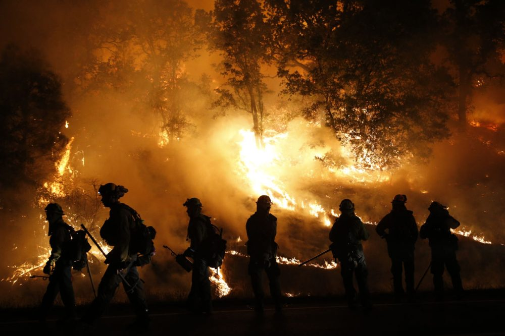 Firefighters with the Marin County Fire Department's Tamalpais Fire Crew monitor a backfire as they battle the Valley Fire on September 13 near Middletown, California. More than 4,000 firefighters from around the country are suing the company that makes sirens on fire trucks for not protecting firefighters' hearing. (Stephen Lam/Getty Images)