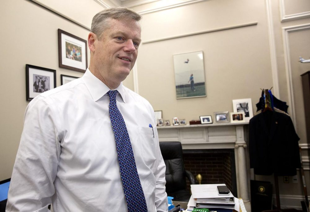 "Gov. Charlie Baker, who's ending his first year as governor, is seen in his State House ""working office"" -- a space covered with family photos and personal memorabilia. (Robin Lubbock/WBUR)"