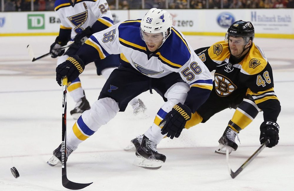 St. Louis Blues' Magnus Paajarvi (56) and Boston Bruins' Colin Miller (48) battle for the puck during the game last night. The Blues won 2-0. (Michael Dwyer/AP)