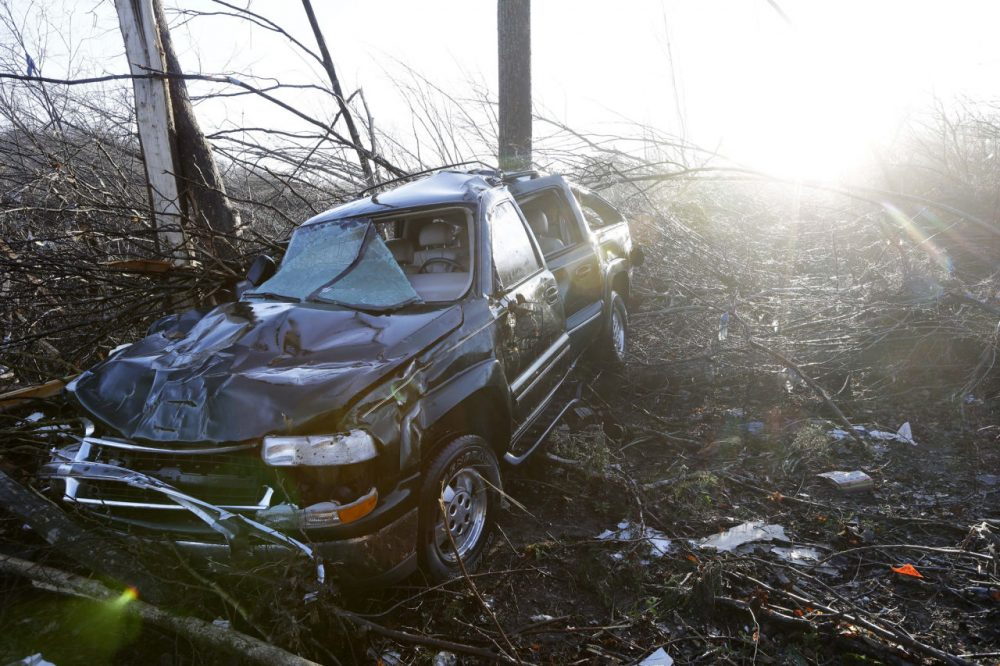 A vehicle sits among debris near the home of Antonio Yzaguirre, 70, and his wife, Ann Yzaguirre, 69, Thursday, Dec. 24 near Linden, Tenn. The couple was found dead after severe storms went through the area Wednesday night. (Mark Humphrey/AP)