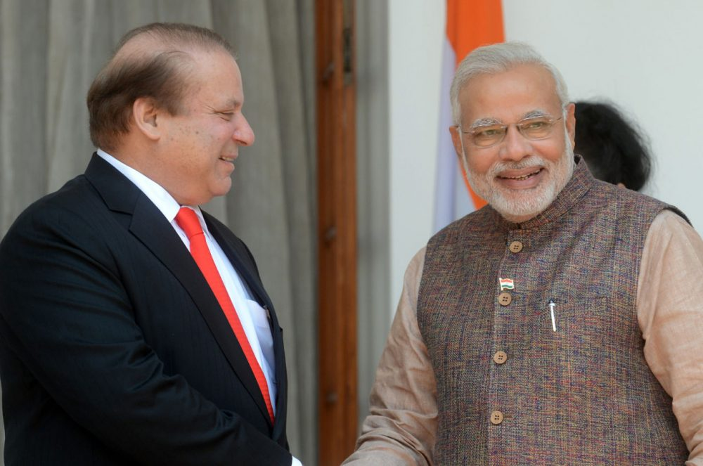 India's newly sworn-in Prime Minister Narendra Modi (R) talks with Pakistani Prime Minister Nawaz Sharif during a meeting in New Delhi on May 27, 2014. The two met again today, this time in Pakistan. (Raveendran/AFP/Getty Images)