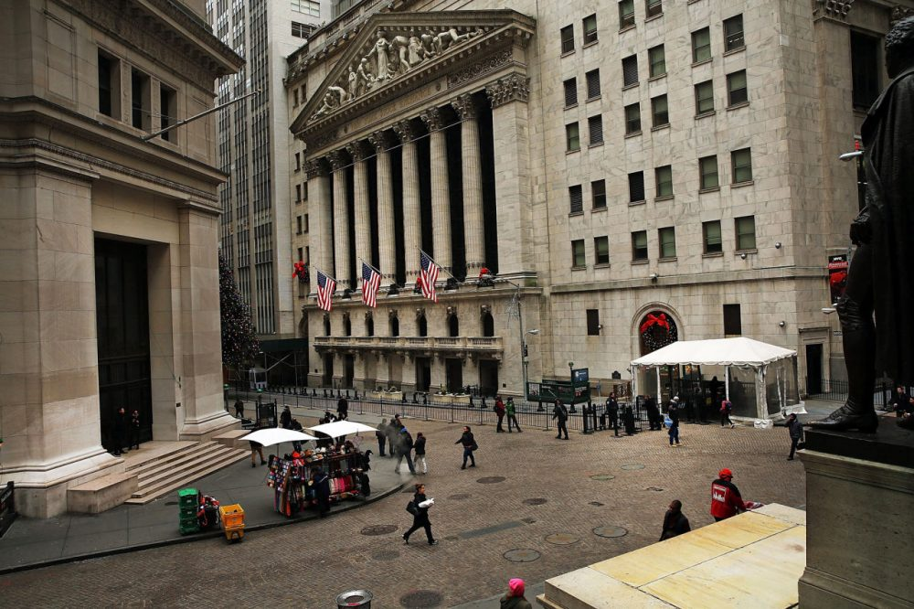 The New York Stock Exchange (NYSE) stands on Wall Street and Exchange Streets on December 21 in New York City. (Spencer Platt/Getty Images)