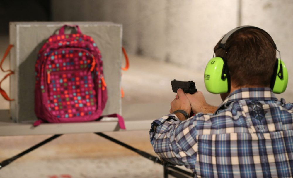 Chief Operating Officer for Amendment II, Rich Brand, shoots a child's backpack with their Rynohide CNT Shield in it on December 21, 2012 in Salt Lake City, Utah. (George Frey/Getty Images)