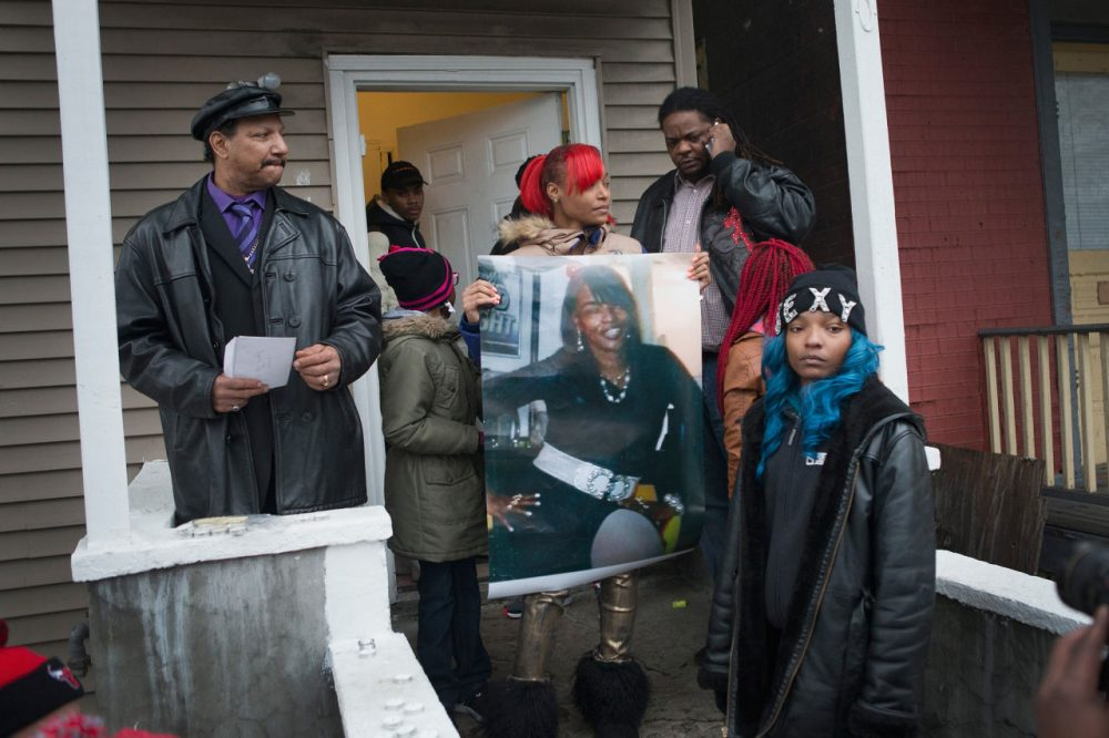 LaTonya Jones, the daughter of Bettie Jones, holds a picture of her mother during a vigil outside her home on December 27 in Chicago, Illinois. Bettie Jones was shot and killed yesterday at the front door of her home by police responding to a domestic dispute call made by her upstairs neighbor. (Scott Olson/Getty Images)