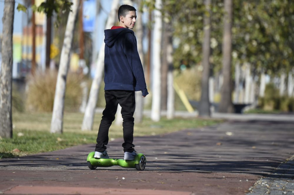A boy rides a hoverboard on the day after Christmas in San Pedro, California. Reports of some hoverboards, also known as self-balancing, two-wheeled scooters catching fire have led to an investigation by the Consumer Product Safety Commission. (Robyn Beck/AFP/Getty Images)