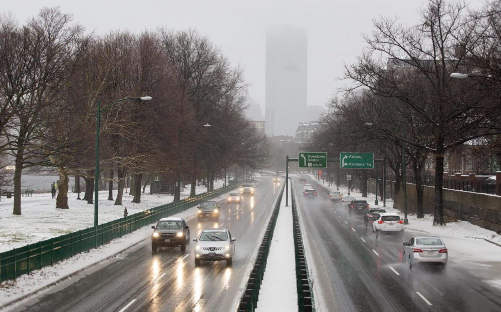 Storrow Drive on Tuesday morning as the snow from Boston's first storm of the season began to turn to sleet and rain. (Robin Lubbock/WBUR)