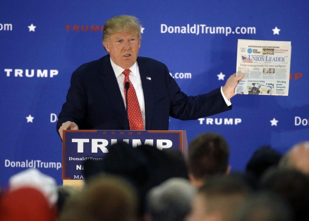 Republican presidential candidate Donald Trump displays a copy of the Union Leader newspaper while addressing an audience during a campaign event Monday, Dec. 28, 2015, in Nashua, N.H. New Hampshire's largest newspaper, the Union Leader, is the latest target of Trump's attacks against the news media. (/Steven Senne/AP)