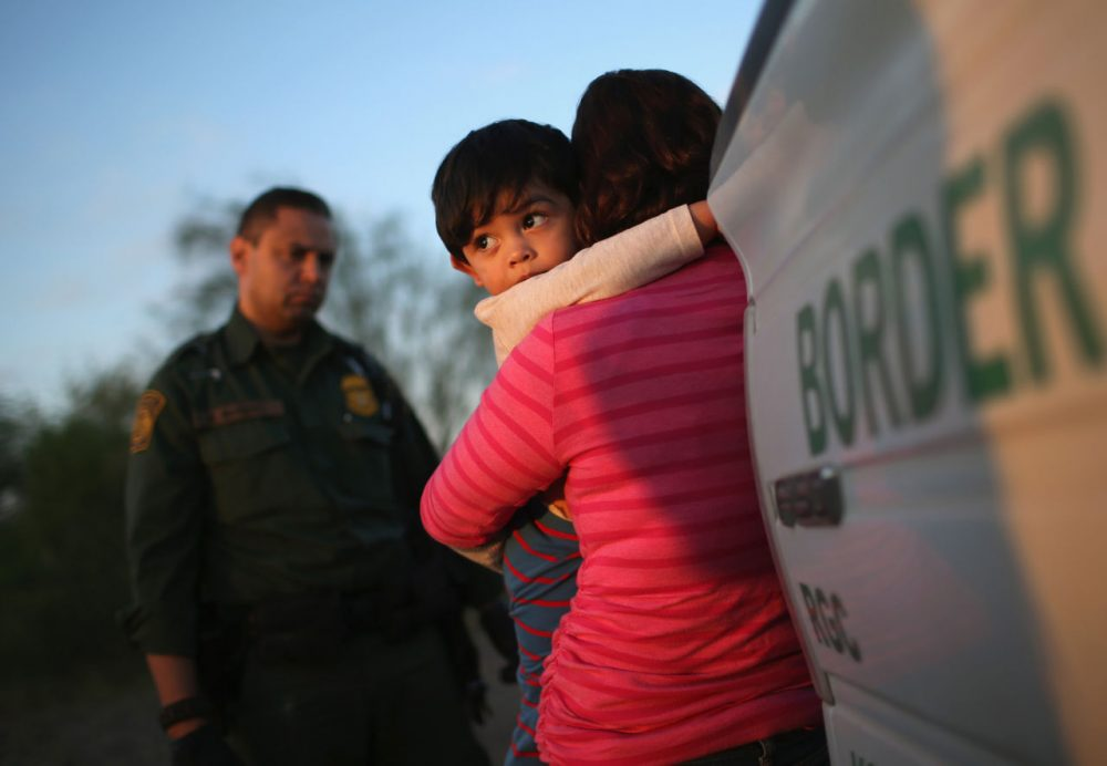 A one-year-old from El Salvador clings to his mother after she turned themselves in to Border Patrol agents on December 7 near Rio Grande City, Texas. The mother said she brought her son on the 24-day journey from El Salvador to escape violence in the Central American country. (John Moore/Getty Images)