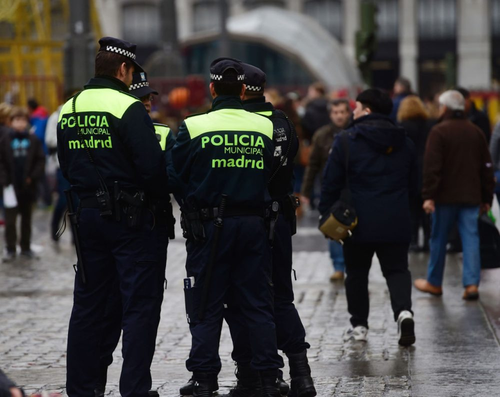 Spanish policemen patrol at Puerta del Sol square in the centre of Madrid, on December 31, 2015. Madrid City Council has set up today unprecedented security arrangements for the New Year's Eve, for the first time limiting the influx to the Puerta del Sol, where thousands of people come to swallow twelve grapes at the stroke of midnight. (Pierre-Philippe Marcou/AFP/Getty Images)