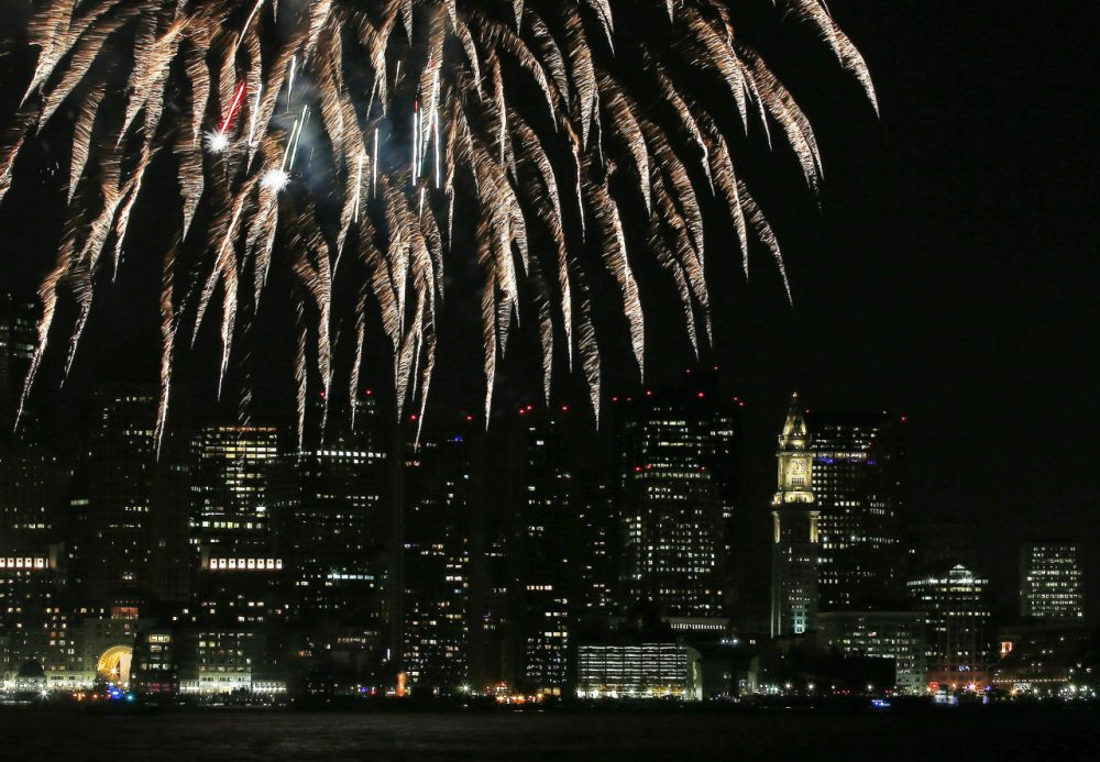 This Jan. 1, 2014, file photo shows fireworks lighting up the sky over Boston Harbor to celebrate First Night in Boston, during New Year's celebrations. (Elise Amendola/AP)