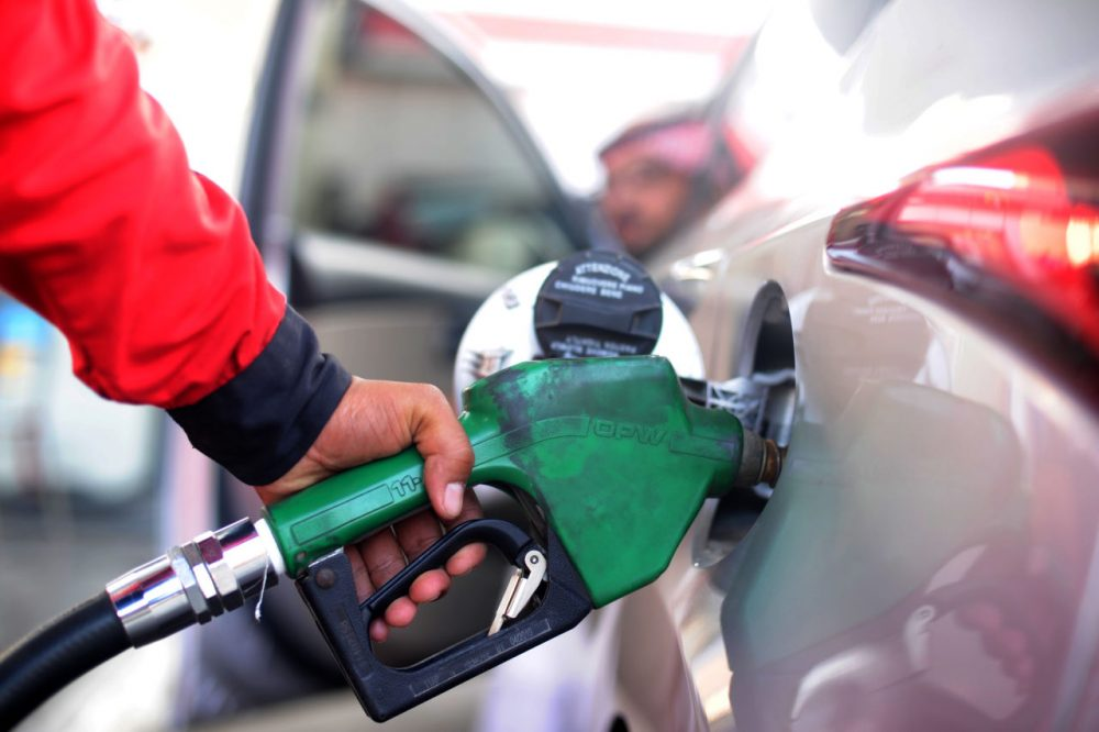 A Saudi employee fills the tank of his car with petrol at a station on December 28 in the Red Sea city of Jeddah. Saudi Arabia said it plans to review the prices of heavily-subsidised power and fuel as part of new measures introduced in the face of low oil prices.   (Amer Hilabi/AFP/Getty Images)