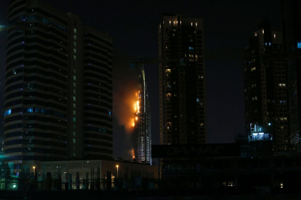 Flames rip through the Address Downtown hotel after it was hit by a massive fire, near the world's tallest tower, Burj Khalifa, in Dubai, on December 31, 2015. People were gathering to watch New Year's Eve celebrations when the hotel caught on fire, with the cause of the blaze still unknown according to the emirate's police chief. (Karim Sahib/AFP/Getty Images)