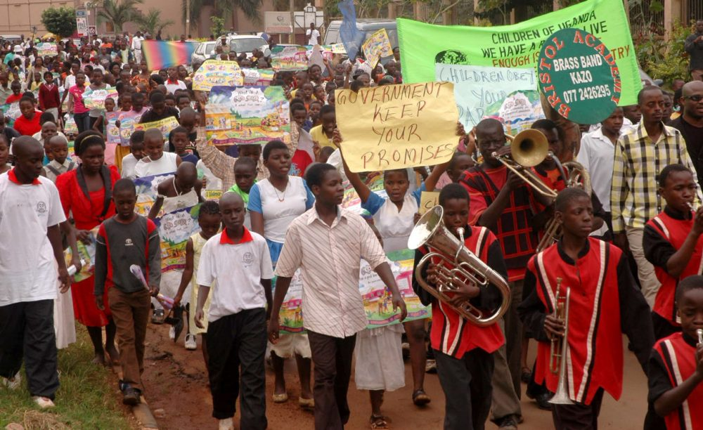 """Thousands of children protested against homosexuality in Uganda in 2010 after the UN Special Rapporteur on health, Anand Grover, warned Friday that the Anti-Homosexuality Bill being considered by the Ugandan Parliament was """"a violation of the fundamental human rights of Ugandans.""""  (Stephen Wandera/AP)"""