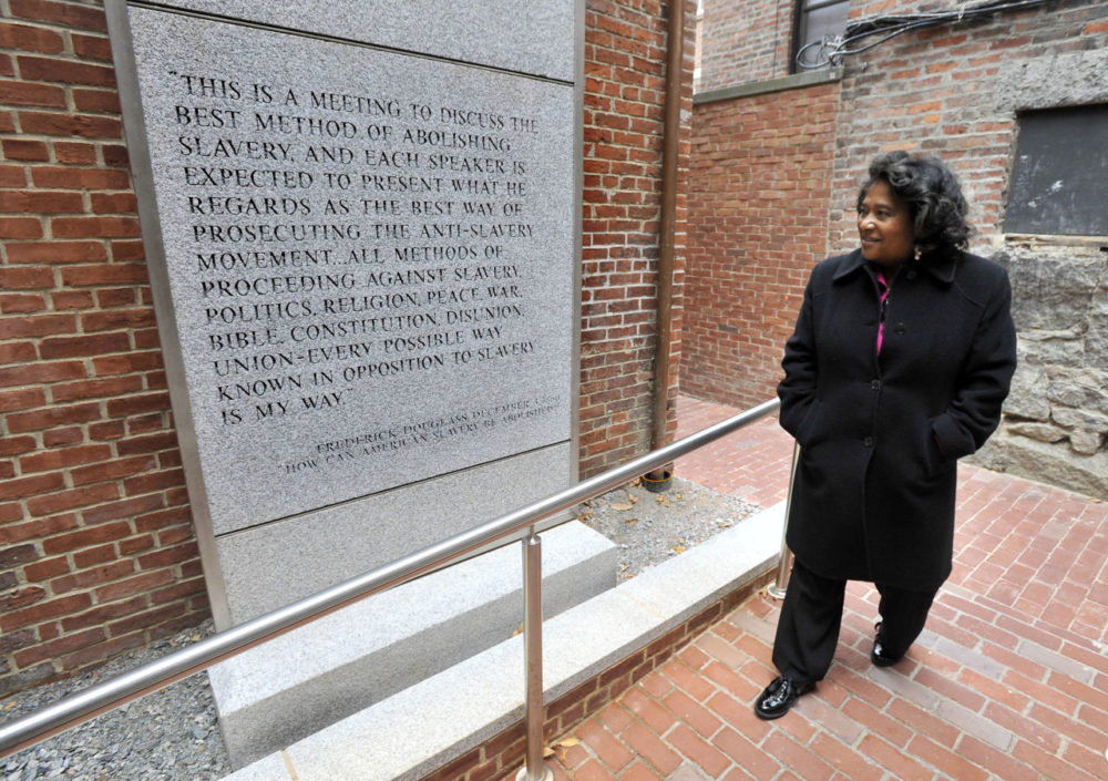 In this file photo, Museum of African American History executive director Beverly Morgan-Welch, walks past a quote from social reformer, statesman, orator and writer Frederick Douglass on a newly constructed entrance to the African Meeting House in Boston. (Josh Reynolds/AP)