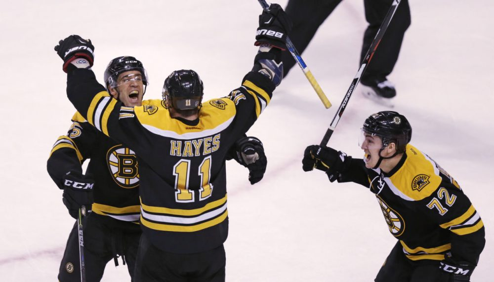 Boston Bruins right wing Jimmy Hayes (11) is congratulated after his third goal of the game by teammates Max Talbot and Frank Vatrano (72) during the third period of Tuesday night's game against the Ottawa Senators. (Charles Krupa/AP)