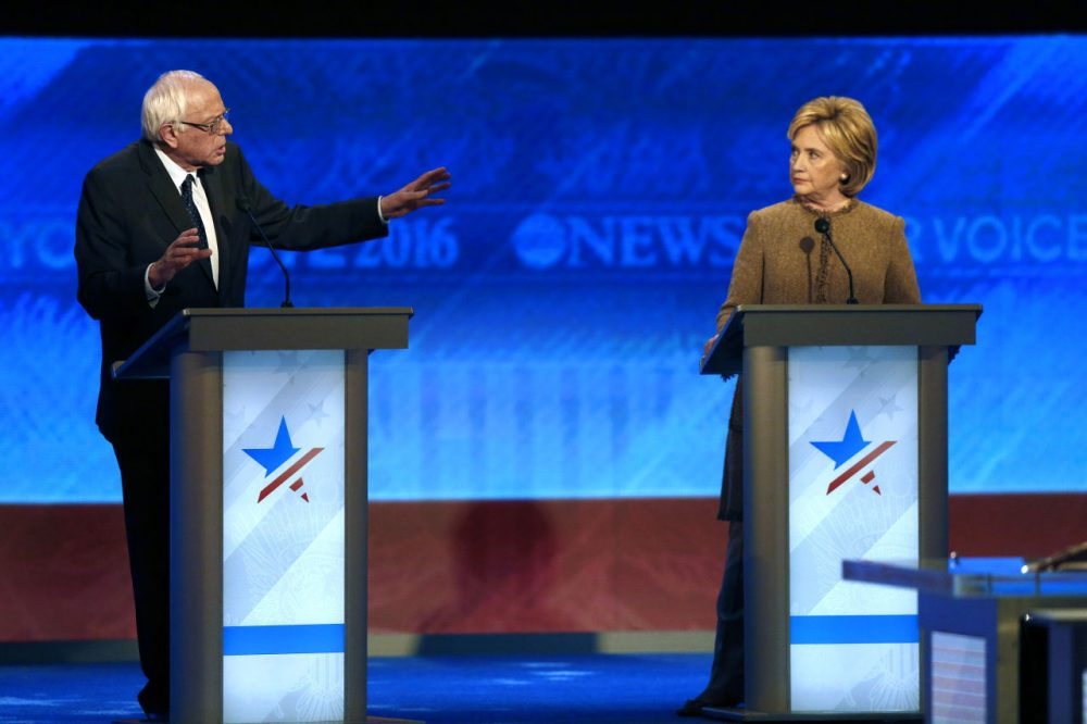 Bernie Sanders speaks to Hillary Clinton during a Democratic presidential primary debate on Saturday in Manchester, N.H. (Jim Cole/AP)