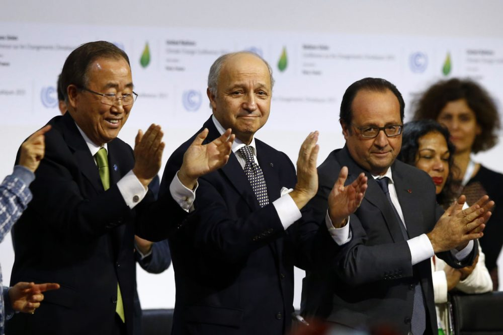 French President Francois Hollande, right, French Foreign Minister and president of the COP21 Laurent Fabius, center, and United Nations Secretary General Ban Ki-moon applaud after the final conference at the COP21, the United Nations conference on climate change, in Le Bourget, north of Paris, Saturday. (Francois Mori/AP)