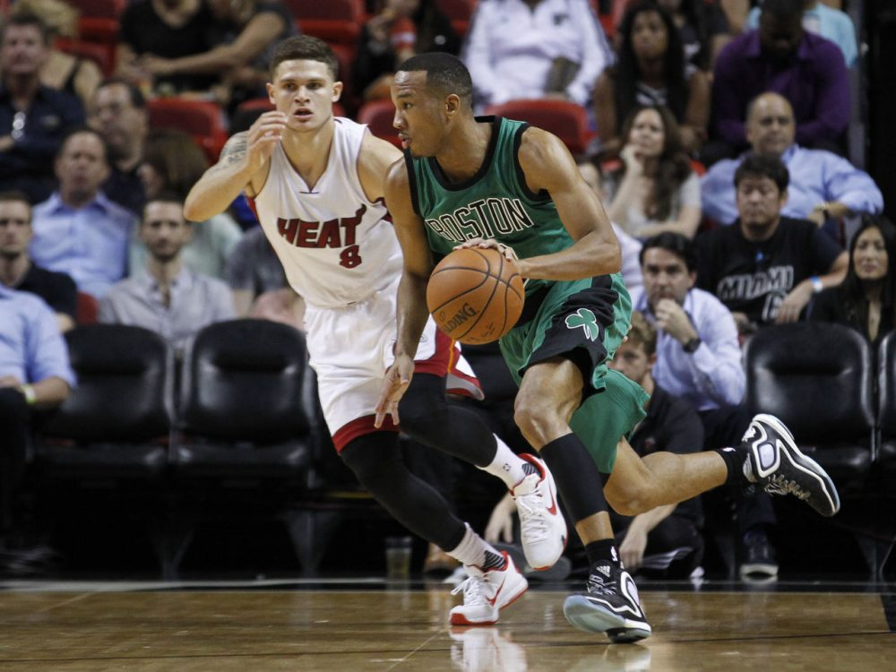 Boston Celtics guard Avery Bradley drives past Miami Heat guard Tyler Johnson in the first half of last night's game in Miami. The Celtics won the game 105-95. (Joe Skipper/AP)