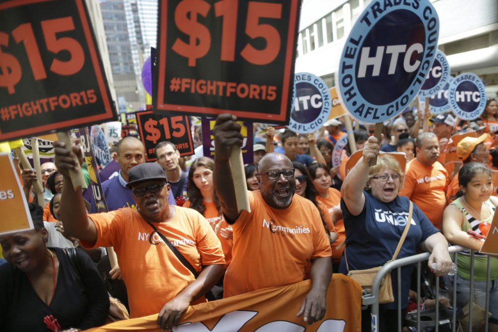 Activists cheered in July after the New York Wage Board endorsed a proposal to set a $15 minimum wage for workers at fast-food restaurants with 30 or more locations in New York. (Mary Altaffer/AP)