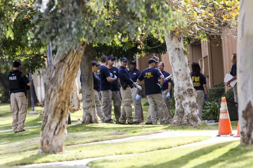 FBI agents search outside a home in connection to the shootings in San Bernardino, Thursday, in Redlands, California. (Ringo H.W. Chiu/AP)