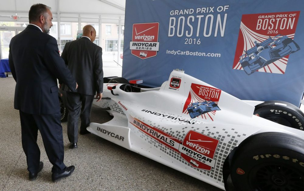 City of Boston Chief of Economic Development John Barros (right) and Tourism, Sports and Entertainment director Ken Brissette (left) examine an IndyCar mock-up in May 2015. (Michael Dwyer/AP)