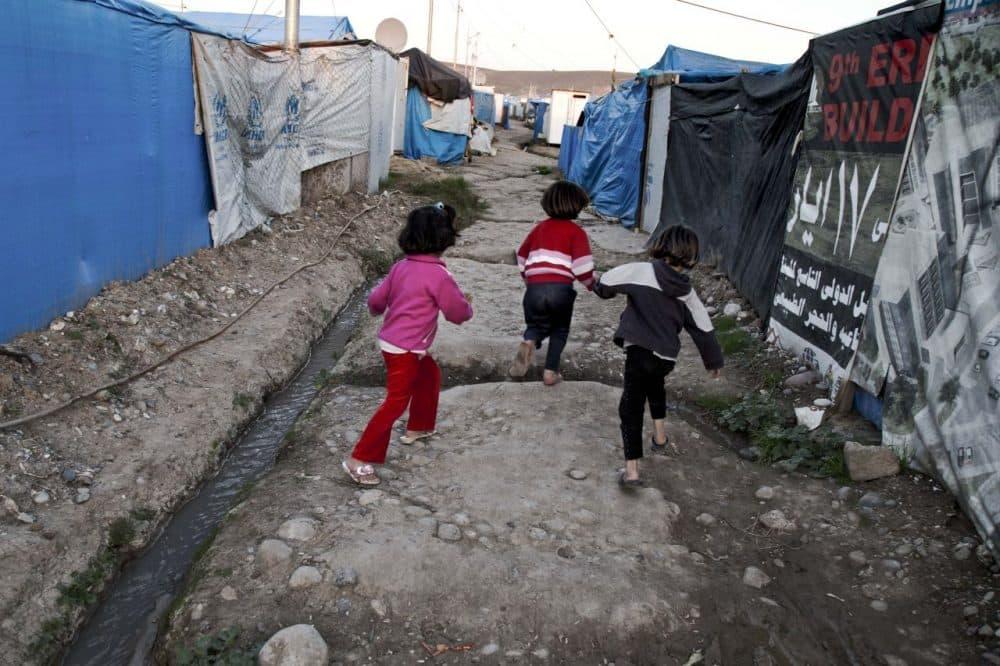 Syrian refugee children run at a temporary refugee camp on Nov. 28 in Irbil, Iraq. (Seivan M. Salim/AP)