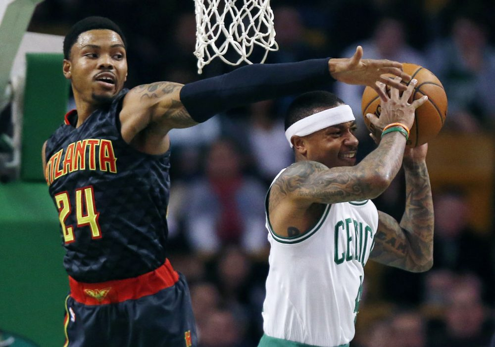 Atlanta Hawks' Kent Bazemore blocks a shot by Celtics' Isaiah Thomas during the first quarter the game in Boston Friday night. (Michael Dwyer/AP)