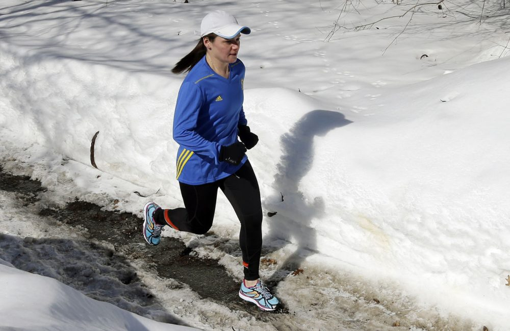 In this Feb. 27, 2015 photo, Becca Pizzi trains for the Boston Marathon along Heartbreak Hill in Newton, Mass. Pizzi, a veteran of 45 marathons, vies to be the first American woman to complete the World Marathon Challenge -- seven marathons in seven days on seven continents -- in January 2016.  (AP Photo/Elise Amendola)
