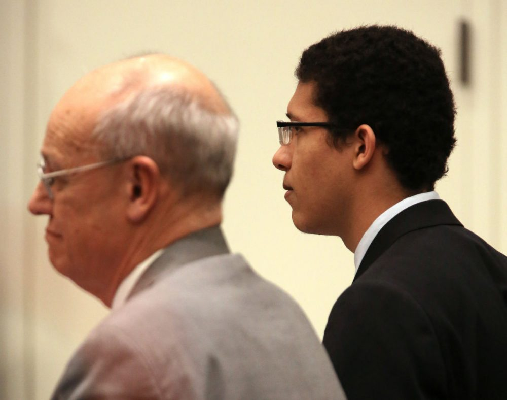 Philip Chism, rights, stares straight ahead beside defense attorney John Osler as the jury reads the verdict in his trial at Salem Superior Court Tuesday. (Ken Yuszkus/The Eagle Tribune via AP/Pool)