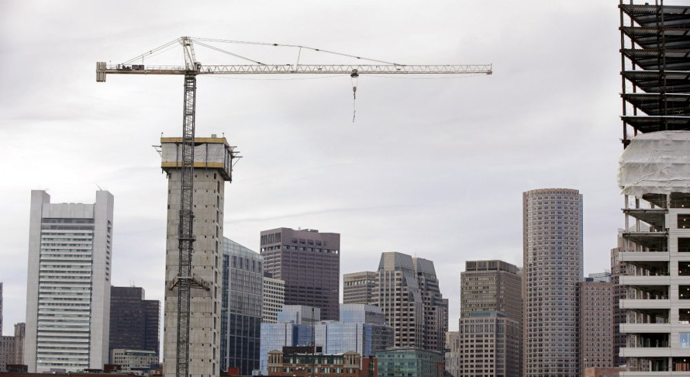 "Mike Broida: ""A city is only as vibrant as its population is diverse.""  Pictured: Several commercial construction projects in the Seaport district of Boston as seen against the backdrop of the city's skyline. (Stephan Savoia/AP)"