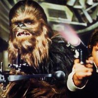 """Peter Mayhew as Chewbacca, left, and Harrison Ford as Han Solo in the original 1977 """"Star Wars: Episode IV - A New Hope"""" film. The new film, """"Star Wars: The Force Awakens,"""" opens in U.S. theaters on Dec. 18, 2015. (AP/Twentieth Century Fox Home Entertainment)"""