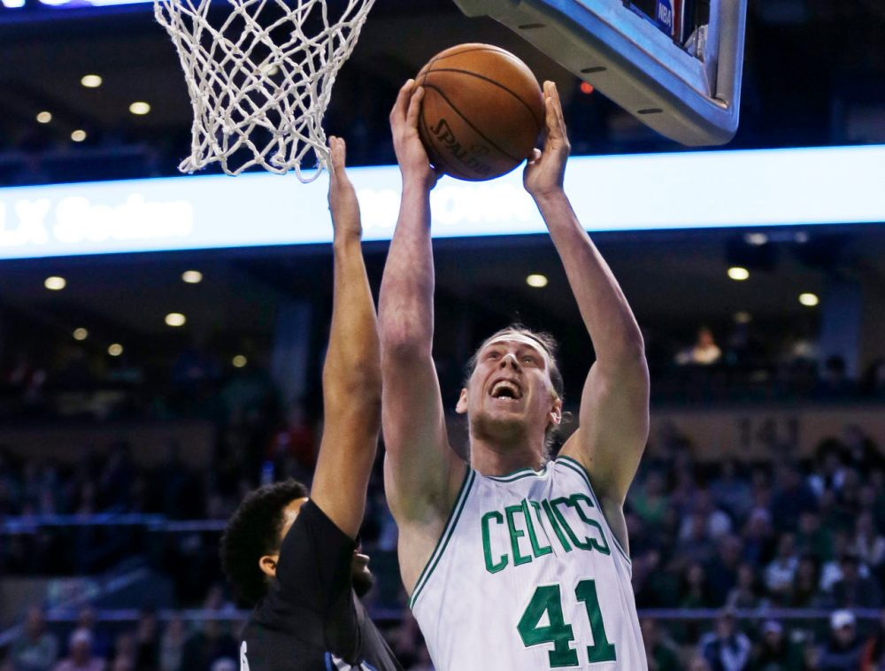 Boston Celtics center Kelly Olynyk drives to the basket against Minnesota Timberwolves center Karl-Anthony Towns (32) during Monday's game. Olynyk scored 19 points as the Celtics defeated the Timberwolves 113-99. (Charles Krupa/AP)