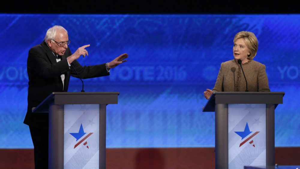 Bernie Sanders and Hillary Clinton speak during the Democratic presidential primary debate Saturday at Saint Anselm College in Manchester, N.H. (Jim Cole/AP)