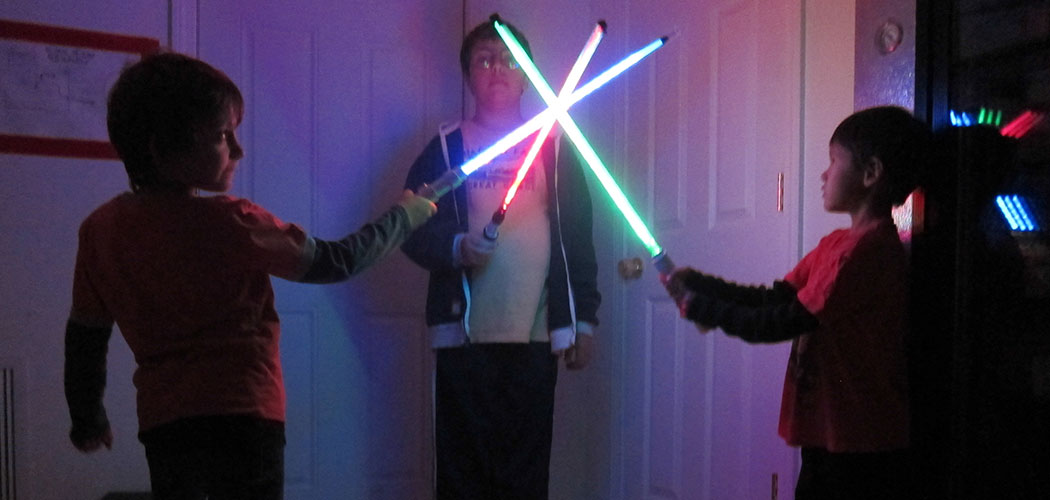 "Trying out the (play) weapons made at a previous ""Lightsaber Build Party"" at Somerville's Parts and Crafts. (Courtesy of Parts and Crafts)"