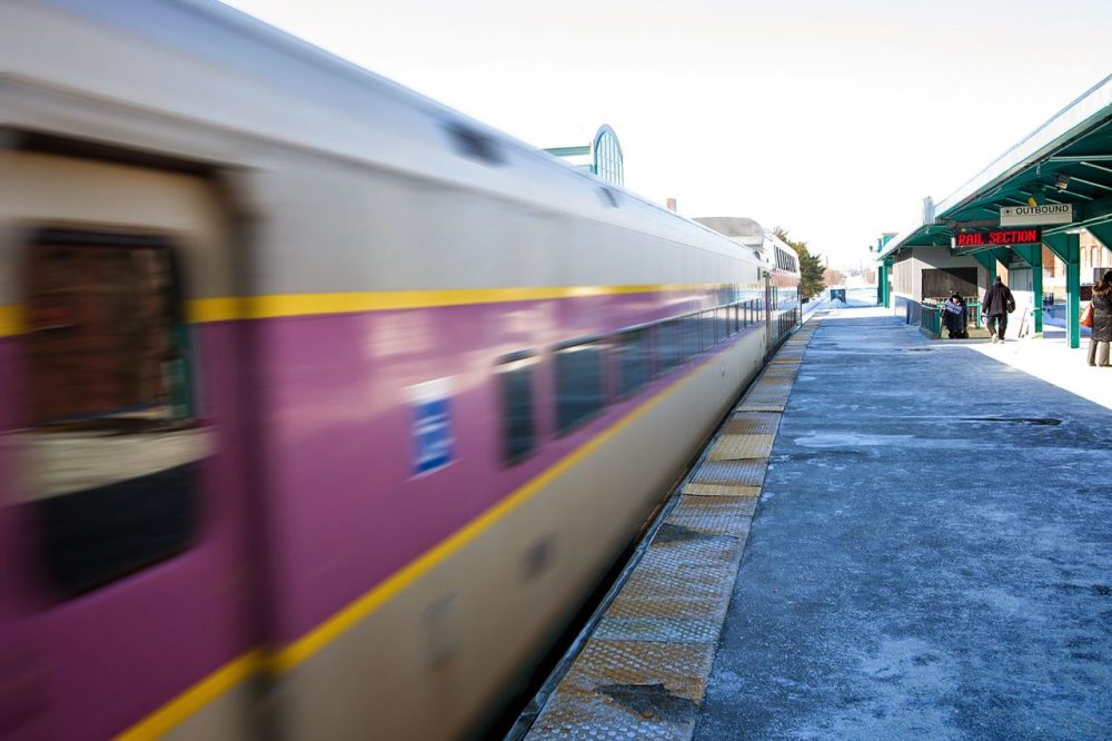 A northbound MBTA commuter rail train leaves Lynn. Proposed fare hikes would effect commuter rail, buses, and T costs for passengers. (Jesse Costa/WBUR)