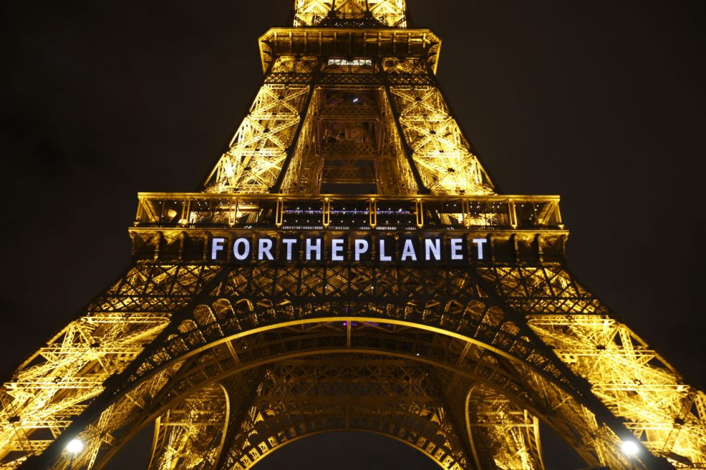 The Eiffel Tower on Friday. The next day, an agreement was finally made by nations participating in the 2015 Climate Conference. (AP Photo/Francois Mori)