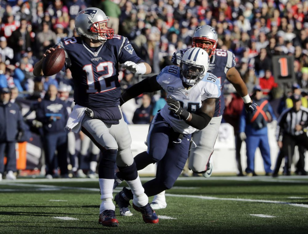 New England Patriots quarterback Tom Brady (12) passes against pressure from Tennessee Titans linebacker Brian Orakpo (98) in Foxborough, Mass. (Steven Senne/AP)