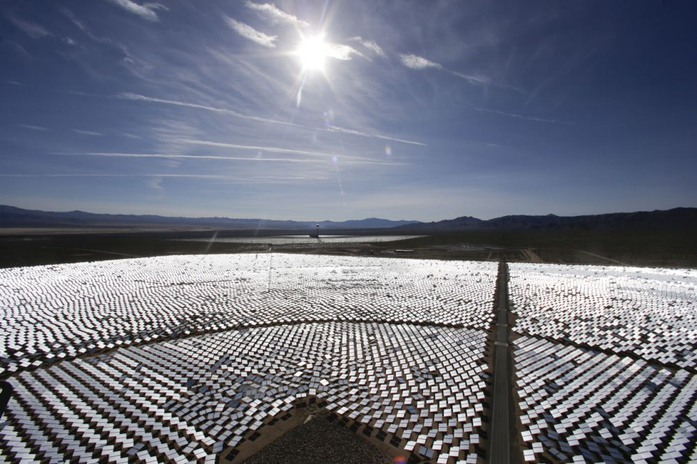 As the price of solar energy goes down, more large corporations are investing in renewable energy like solar. Pictured here is the world's largest solar-thermal power plant project, located near the California-Nevada border. (AP Photo/Chris Carlson)