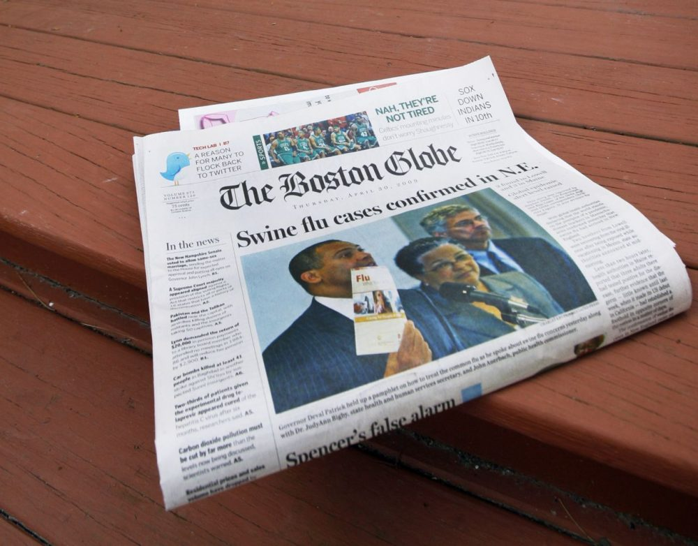 The Boston Globe after a home delivery in North Andover, Mass. in 2009. (Elise Amendola/AP)