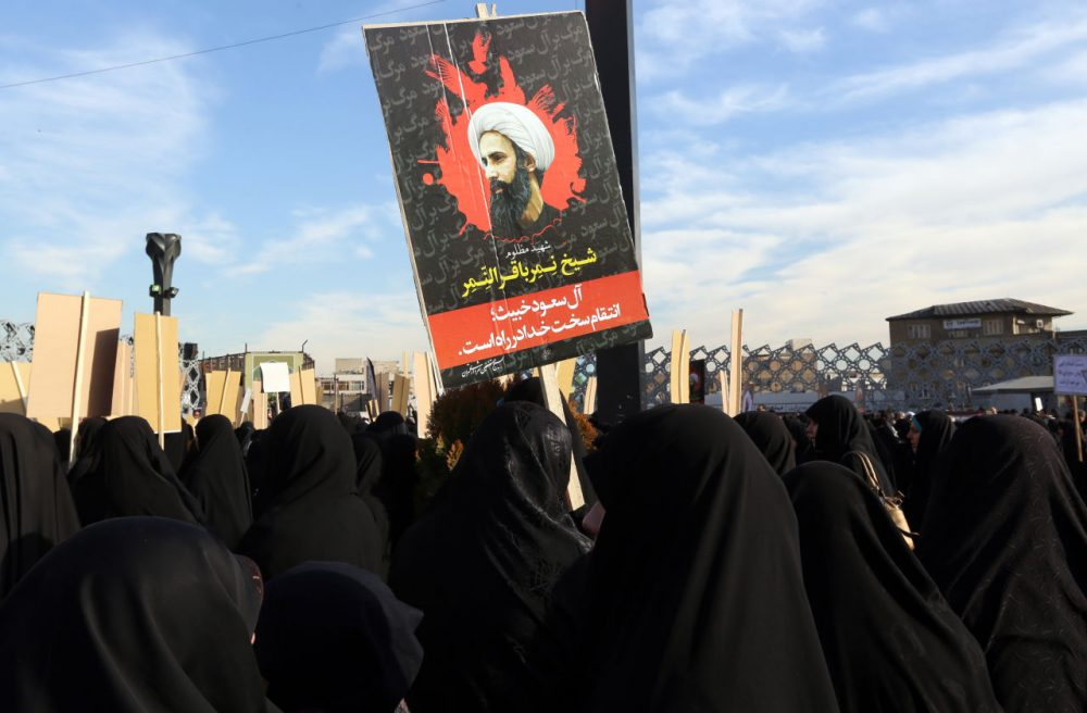 Iranian women gather during a demonstration against the execution of prominent Shiite Muslim cleric Nimr al-Nimr (portrait) by Saudi authorities, at Imam Hossein Square in the capital Tehran on January 4, 2016. Tensions between Iran and its Sunni Arab neighbors reached new heights as Saudi Arabia and Gulf allies cut or downgraded diplomatic ties with Tehran in a row over the execution of a Shiite cleric. (Atta Kenare/AFP/Getty Images)