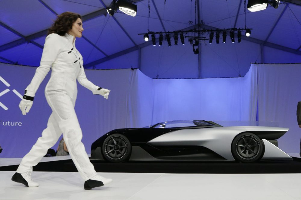 A driver walks in front of the FFZero1 by Faraday Future at CES Unveiled, a media preview event for CES International, on Monday, Jan. 4, 2016, in Las Vegas. The high-performance electric concept car was unveiled during a news conference by Faraday Future. (Gregory Bull/AP)