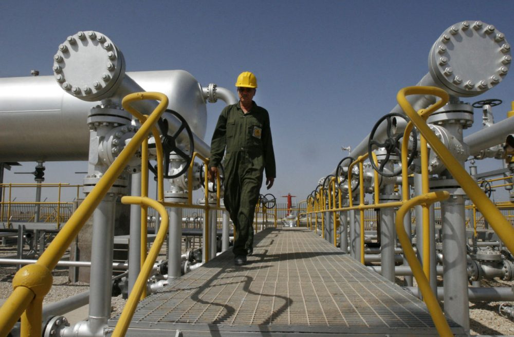 In this  April 15, 2008 photo, Iranian oil technician Majid Afshari makes his way at the oil separator facilities in Azadegan oil field, near Ahvaz, Iran. Iran is OPEC's second-largest producer. (Vahid Salemi/AP)