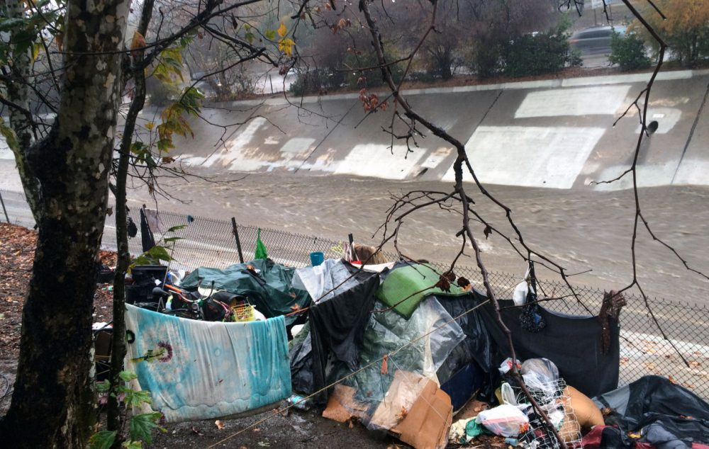A homeless encampment is left abandoned along the Arroyo Seco north of downtown Los Angeles on Tuesday, Jan. 5, 2016. Los Angeles authorities say police are patrolling riverbeds to compel homeless people to leave low-lying areas as a major storm gains strength and rain gets heavier. Steady and sometimes heavy rain in Southern California is shaking loose rocks and causing flooding on some roadways as an El Nino-powered storm moves through the region. (Christopher Weber/AP)