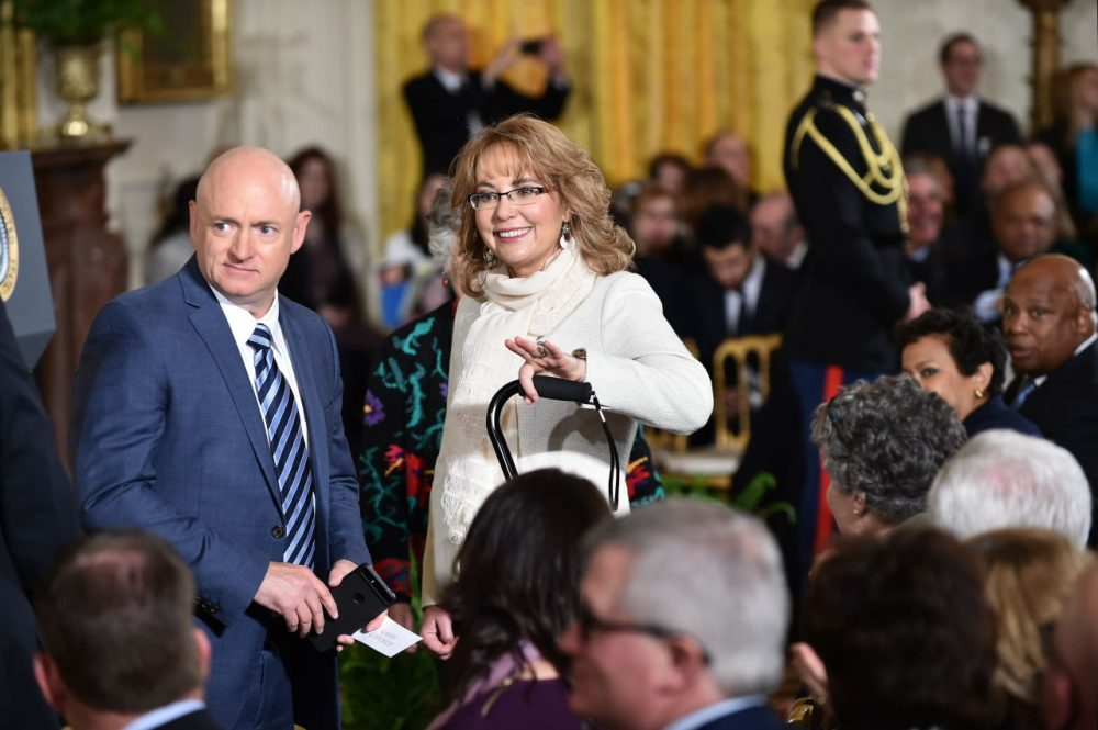 Former congresswoman and gun violence survivor Gabrielle Giffords (center) and her husband astronaut Mark Kelly (left) arrive to hear President Barack Obama speak on reducing gun violence in the East Room of the White House on January 5, 2016 in Washington, D.C. (Mandel Ngan/AFP/Getty Images)