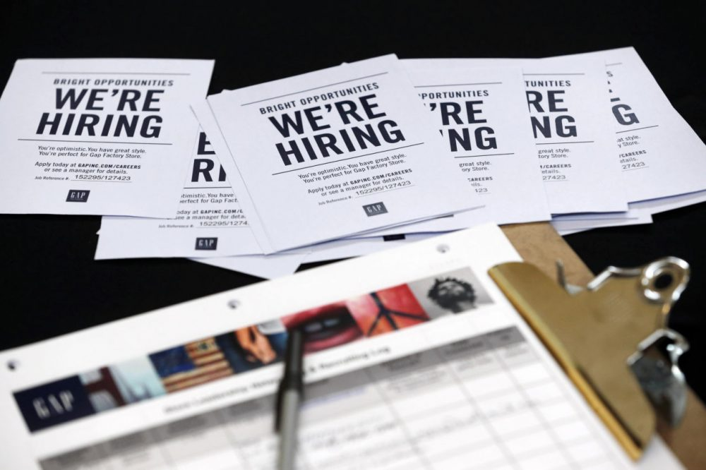Job applications and information for the Gap Factory Store sit on a table during a job fair at Dolphin Mall in Miami, on Oct. 6, 2015. (Wilfredo Lee/AP)