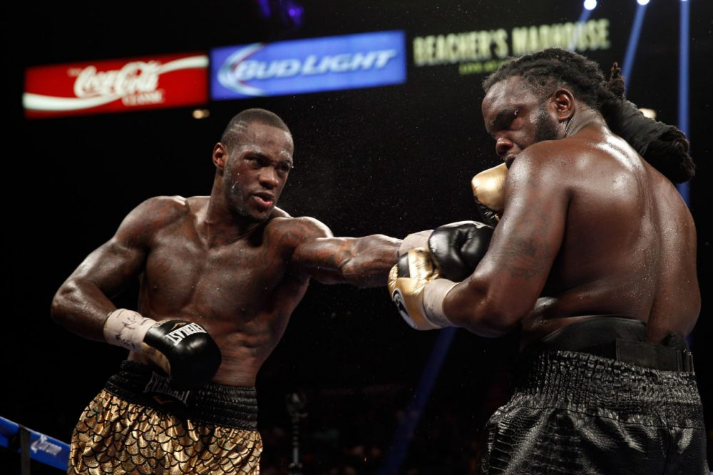 Deontay Wilder, left, is the current WBC heavyweight champion and won a bronze medal in the 2008 Summer Olympics in Beijing. (Steve Marcus/Getty Images)