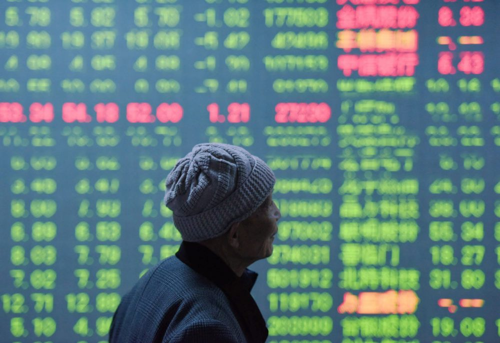 An investor looks at a screen showing stock market movements at a securities firm in Hangzhou, in eastern China's Zhejiang province on January 11, 2016. China's benchmark Shanghai stock index closed down 5.33 percent on January 11, as investors continued to worry over the state of the world's second largest economy, dealers said. (STR/AFP/Getty Images)