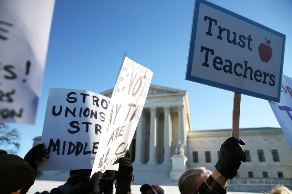 People for and against unions hold up signs in front of the U.S. Supreme Court building January 11, 2016 in Washington, D.C. (Mark Wilson/Getty Images)