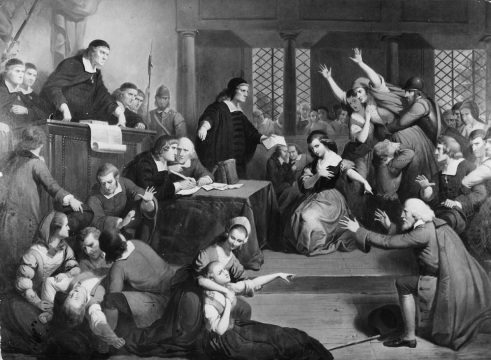 In this image, people faint and cause disorder in a courtroom during the 1692 trial of suspected witch, George Jacobs. (Douglas Grundy/Three Lions/Getty Images)