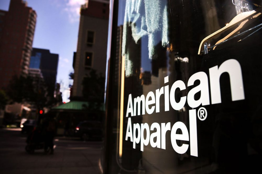 The  American Apparel store logo is displayed in a window of a store on October 5, 2015 in New York City. American Apparel has filed for Chapter 11 bankruptcy protection nearly a year after the ousting of founder and CEO Dov Charney. In its latest quarter, the youth driven clothing company reported a loss of $19.4 million.  (Spencer Platt/Getty Images)